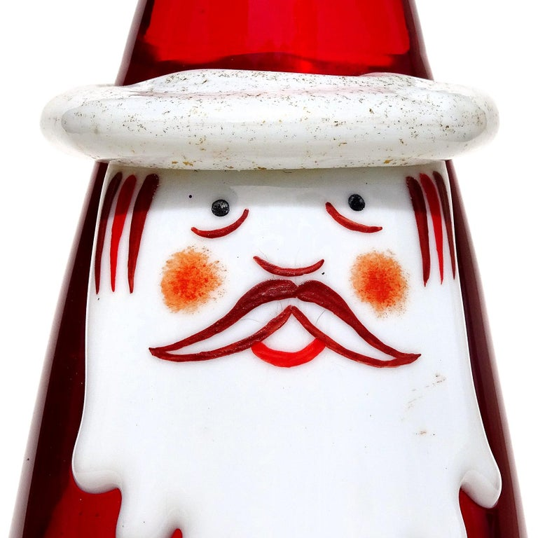 Beautiful vintage Murano hand blown red, white and gold flecks Italian art glass Santa Claus sculpture / paperweight. Documented to the Fornasa De Murano A L'Insegna Del Moreto, with original and intact label still attached. It also have a silver