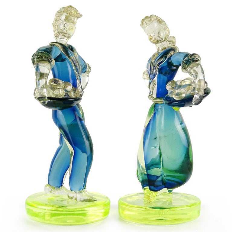 Gorgeous, elegant and large Murano hand blown Sommerso blue and yellow green Italian art glass man and woman figures, holding fruit baskets. Attributed to designer Alfredo Barbini. The farmers or peasants are covered with a layer of