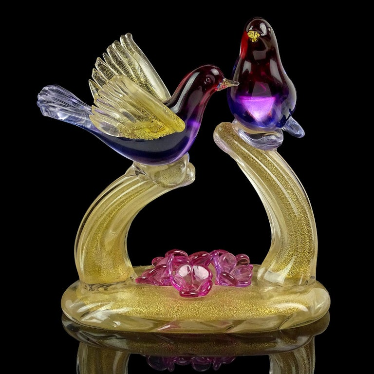Gorgeous vintage Murano hand blown Sommerso with gold flecks art glass courting love birds sculpture. Documented to designer Alfredo Barbini. The bird colors create an Ombre fade, from red, purple to blue. The branches and base are profusely covered