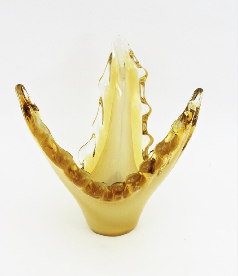 Eleganthand blown Sommerso and lattimo yellow Murano glass vase / centerpiece, Italy, 1950s. Triple cased glass (yellow, over white lattimo glass over yellow glass). It has an scalloped rim with amber accents. This Murano glass vase is perfect to