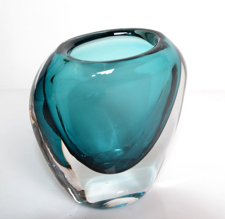 Murano blown art glass vase in turquoise blue and transparent glass from Italy. The opening with 2.25 x 1.5 inches width is for a little bouquet. Mid-Century Modern unique glass art very elegant and practical.
