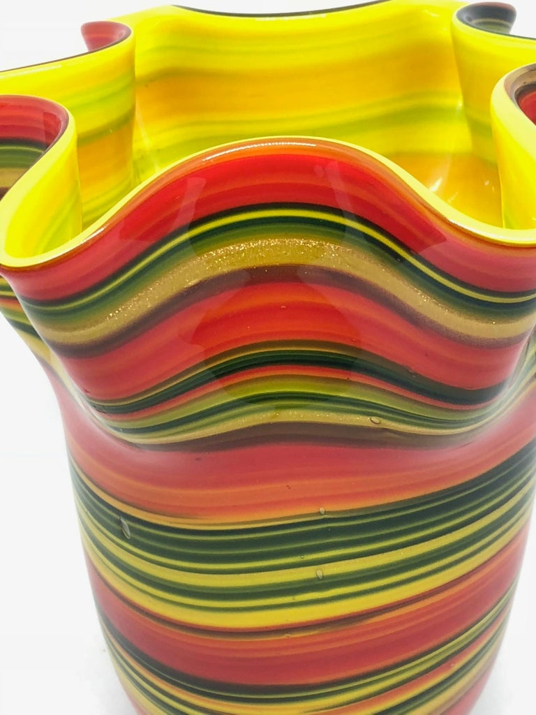 Beautiful handblown Murano Glass bowl. Red, black yellow and gold glitter make this Italian Venetian glass bowl a real showstopper. Created by the Fratelli Toso company, the Italian art glass handkerchief Fazzoletto vase. A beautiful addition to any