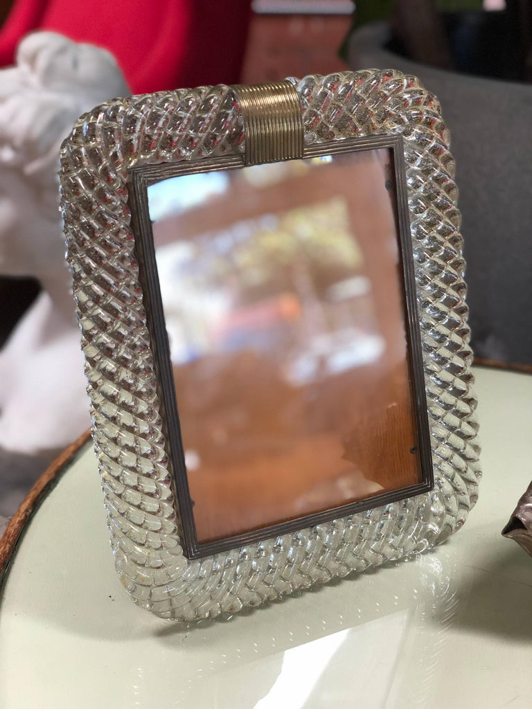 Venini table picture frame in glass and brass, Italy, 1940s with original 'easel' support. Rare heavy Murano Venini glass frame with incredible braided texture, brass accent.