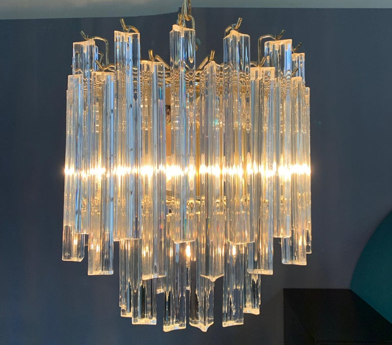 Classic Venini round bi-level chandelier with 9-light bulbs and multi setting lights.