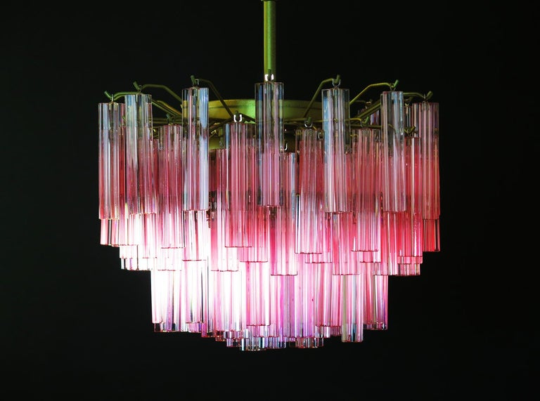 Fantastic vintage Murano chandelier made by 107 Murano crystal prism quadriedri in a structure painted gold. The glasses have various shades of pink that enhance even more the beauty of this chandelier.