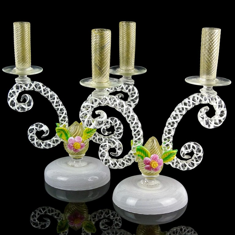 Gorgeous pair of large antique Murano hand blown Filigrana ribbons with gold flecks and flower accents Italian art glass double candlesticks / candelabra. The holders have scroll decoration arms, with white ribbons intertwined, center with gold leaf