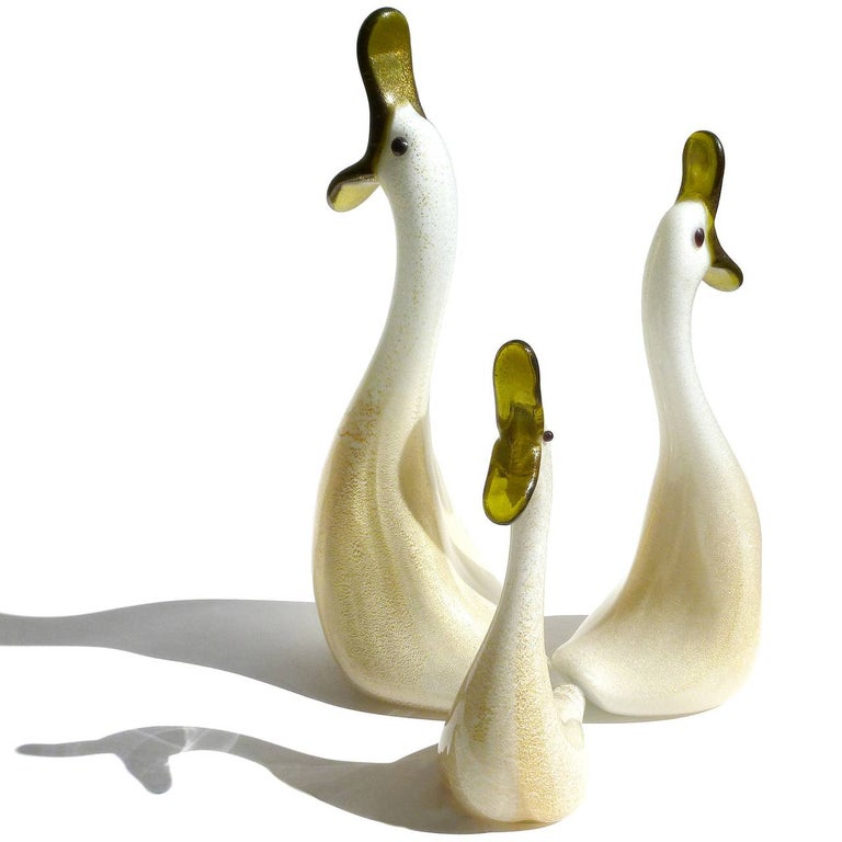 Adorable vintage Murano hand blown white and gold flecks Italian art glass duck family figurines / sculptures. These cute birds just make me laugh every time I look at them. Can you just imagine the choir of voices coming out of those beaks! Dad,
