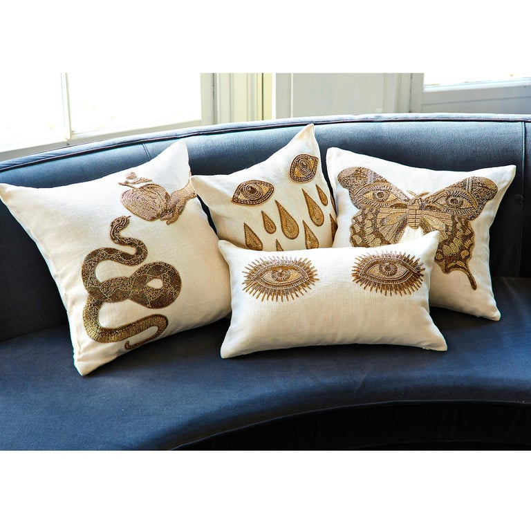 Surreal style. Handcrafted intricate gold beadwork embroidered on chunky ivory linen, our Muse Pillows are the perfect mix of the decadence of Halston and the madness of Dali. Crafty, couture, and exotic, these pillows will remind your guests