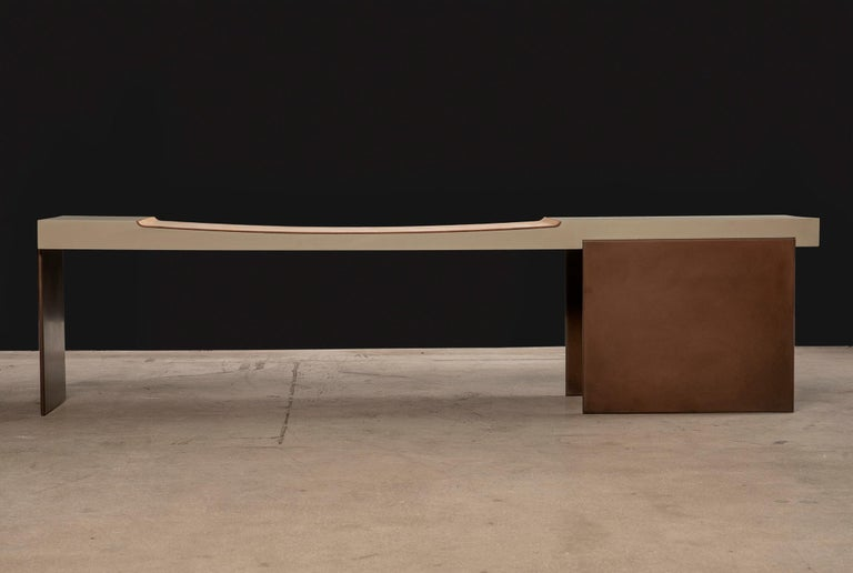 The Museum bench imparts a statement of quiet strength and elegance. Its contemporary Minimalist design is balanced with substantial materials, tones and textures. The solid wood body is coated in a matte celadon finish and has a carved seating