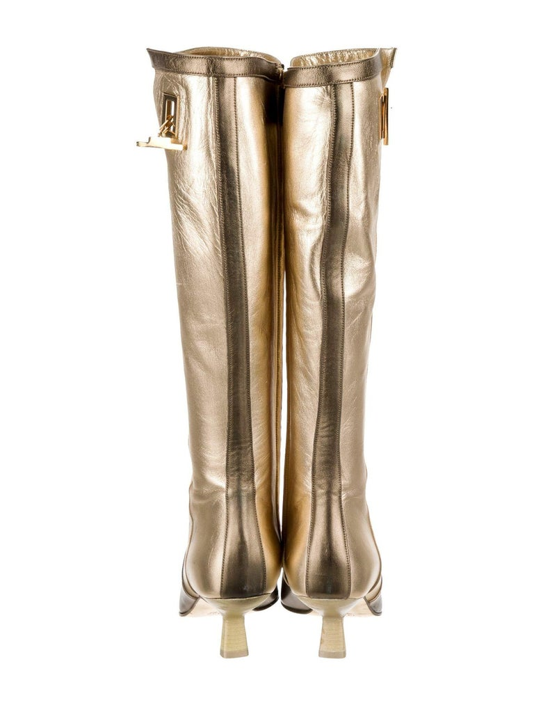 COLLECTOR'S ITEM  GUCCI COLLECTION BY TOM FORD FOR FALL / WINTER 2000  Gold & Bronze Leather boots These boots are part of the permanent collection of the Phoenix Art Museum, gift of Neiman Marcus and were also featured in the Gucci cataloge in