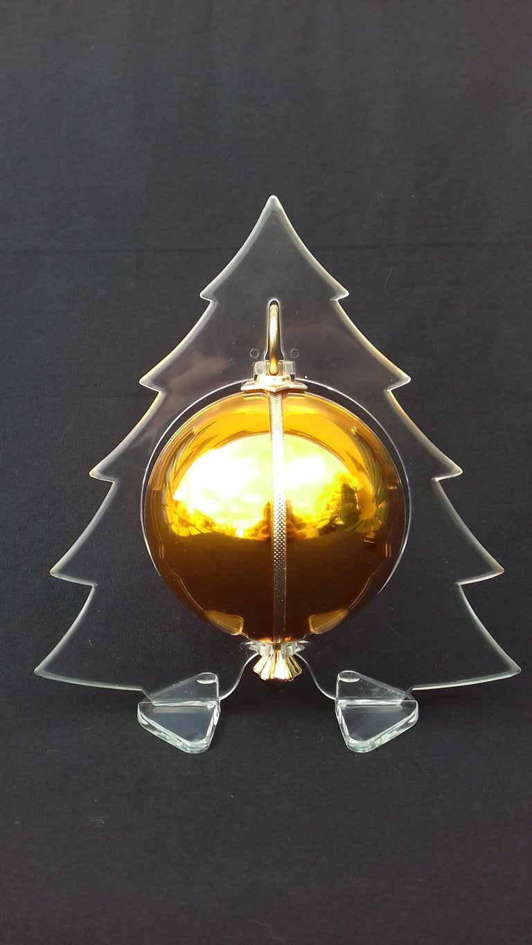 Pull the string, put the tree on your table, and listen to the magic of Christmas  Rare and Gorgeous Christmas Ball Music Box   Pull the hook, a string will come out and go into the ball playing