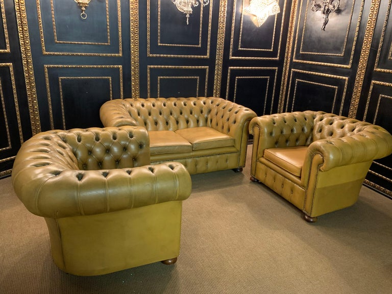 We are delighted to offer this stunning very rare handmade in England mustard yellow leather sofa and armchairs. Where to begin! This suite is absolute eye candy from every angle, it has the original leather hide, it has been hand dyed this lovely