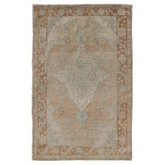 Muted Colored Turkish Oushak Rug is Subdued Medallion Design