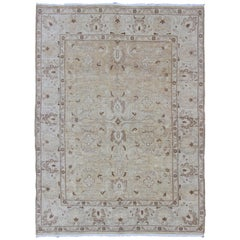Muted Colors Afghan Rug with All-Over Design and Light Buttery Color Background