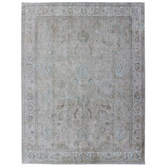 Muted Gray, Blue, and Ivory Vintage Persian Tabriz Rug with Floral Design
