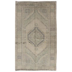 Muted Turkish Oushak with Layered Diamond Medallion Design in Neutral Colors