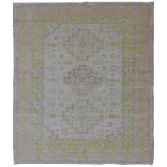 Muted Vintage Spanish Rug with Elegant Tri-Medallion Design and Floral Motifs