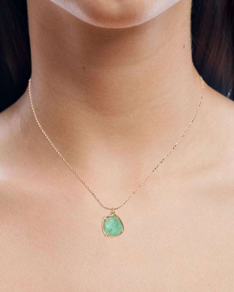Contemporary 18 Karat rose gold pendant set with an organic tumbled claw set Muzo colombian emerald weighing 4.45 carats.  Muzo Emerald Colombia Heritage Chakana drop set with 4.45 carats Emerald.  Chakana takes its name from the sacred and