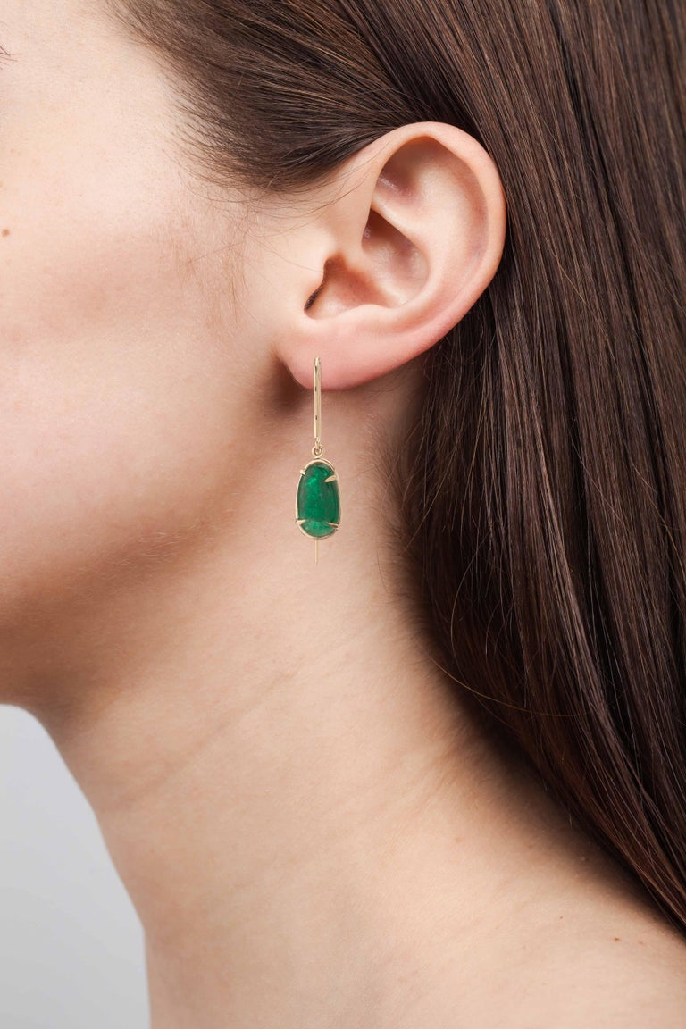 Classic style shepard hook earring in 18 Karat yellow gold with claw set Muzo Colombian emeralds weighing 6.72 carats.  Muzo Emerald Colombia Heritage Chakana Earrings set with 6.72 carats Emerald   Chakana takes its name from the sacred and