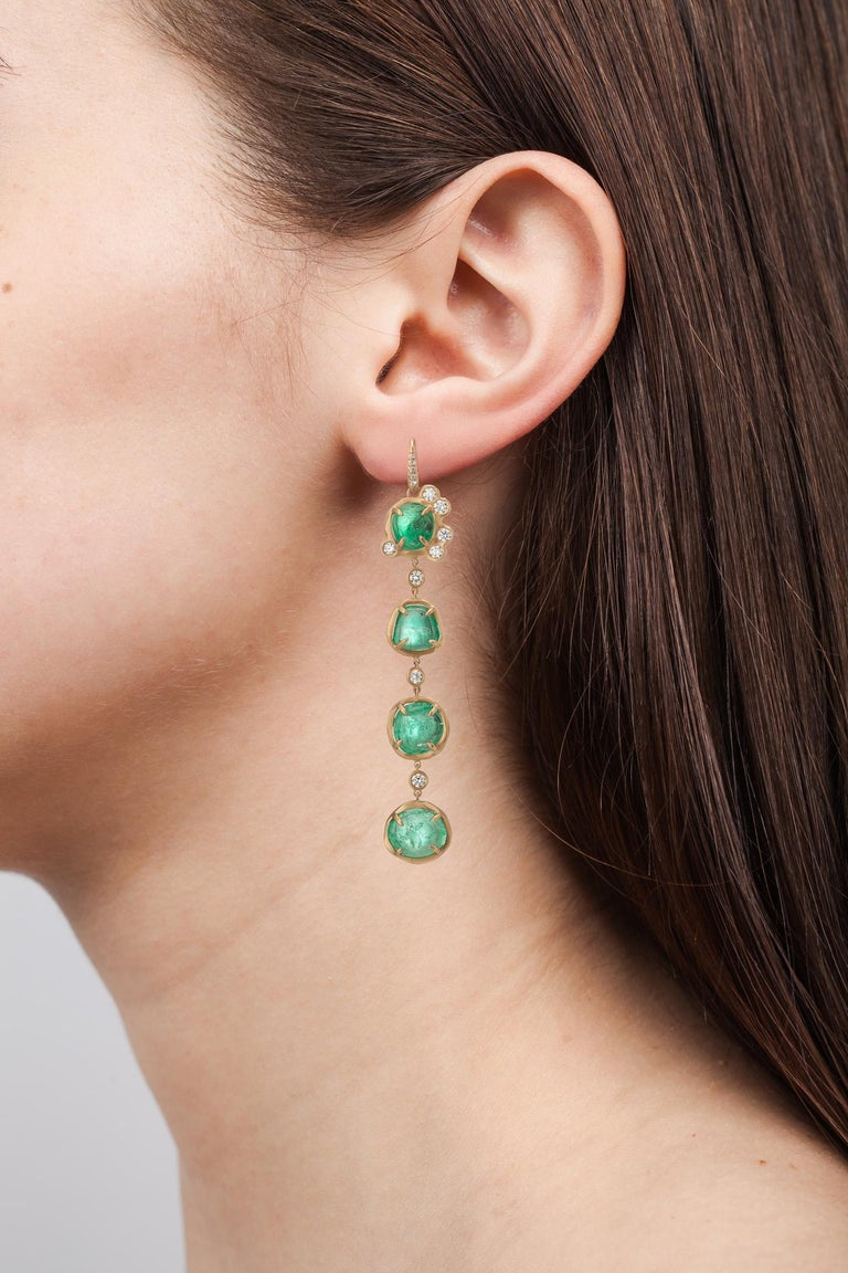 18 Karat yellow gold drop earrings set with alternating Muzo Colombian emeralds of 38.94 carats and single set diamonds weighting 1.25 carats.  Muzo Emerald Colombia Heritage Muisca Earrings set with 38.94 carats Emerald.  Named in honor of the
