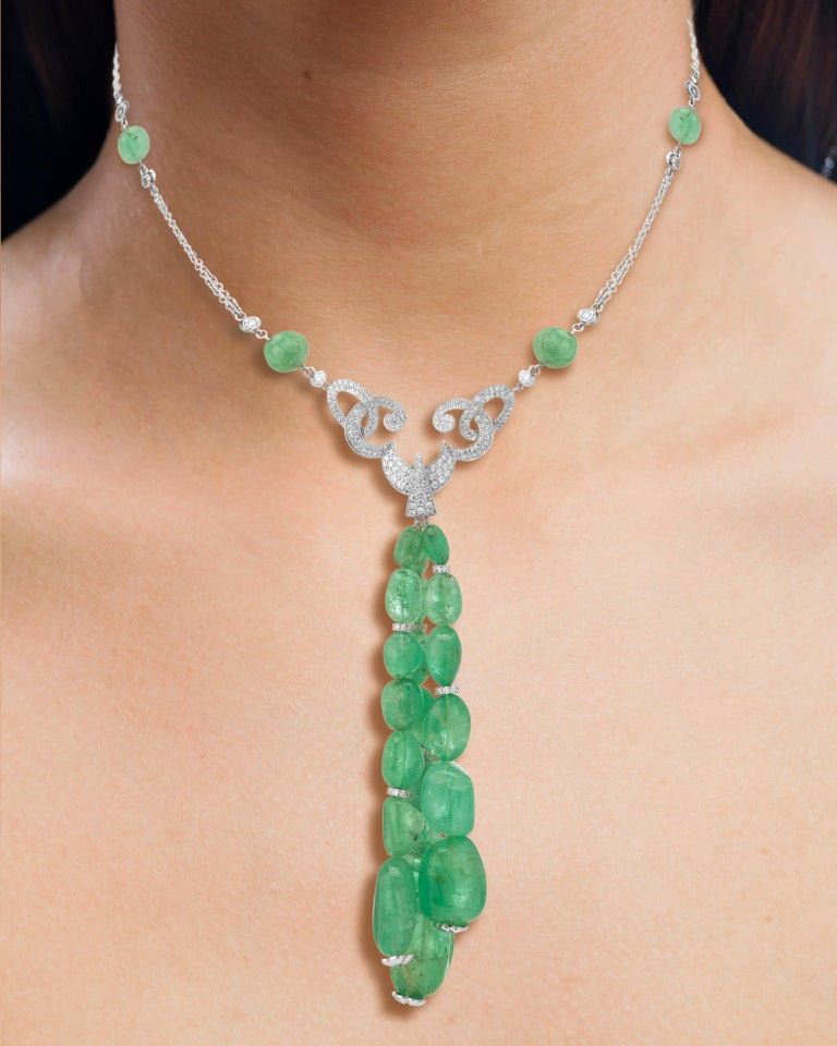 18 Karat white gold renaissance styled necklace featuring Muzo colombian emerald tassles weighing 131.35 carats and 2.09 carats of round brilliant diamonds  Muzo Emerald Colombia Heritage Verity Pendant set with 131.35 carats Emerald  Verity is a