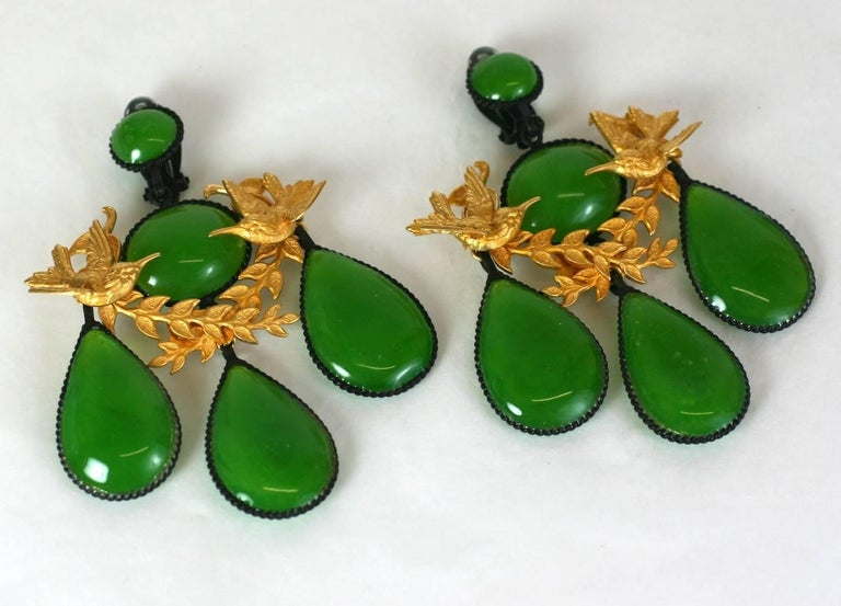 Oversized Girandole Garland Earrings handmade in the Parisian studios of MWLC. An late 18th century classic form reworked in blackened and gilt metal with opaline lime green pate de verre poured glass. A garland of gilt songbirds completes the
