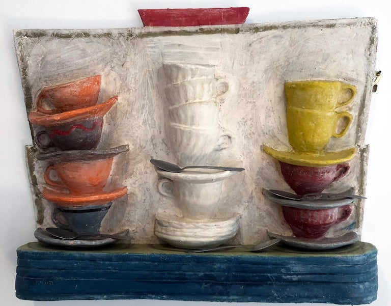 'Cup Stax' by American artist Myron Melnick. Cast paper cups and saucers, 18 x 24 in. Cast paper sculpture in red, blue, pink, yellow, and white, A unique work created using a mold and colored with charcoal, oil stick and other mediums. Can be