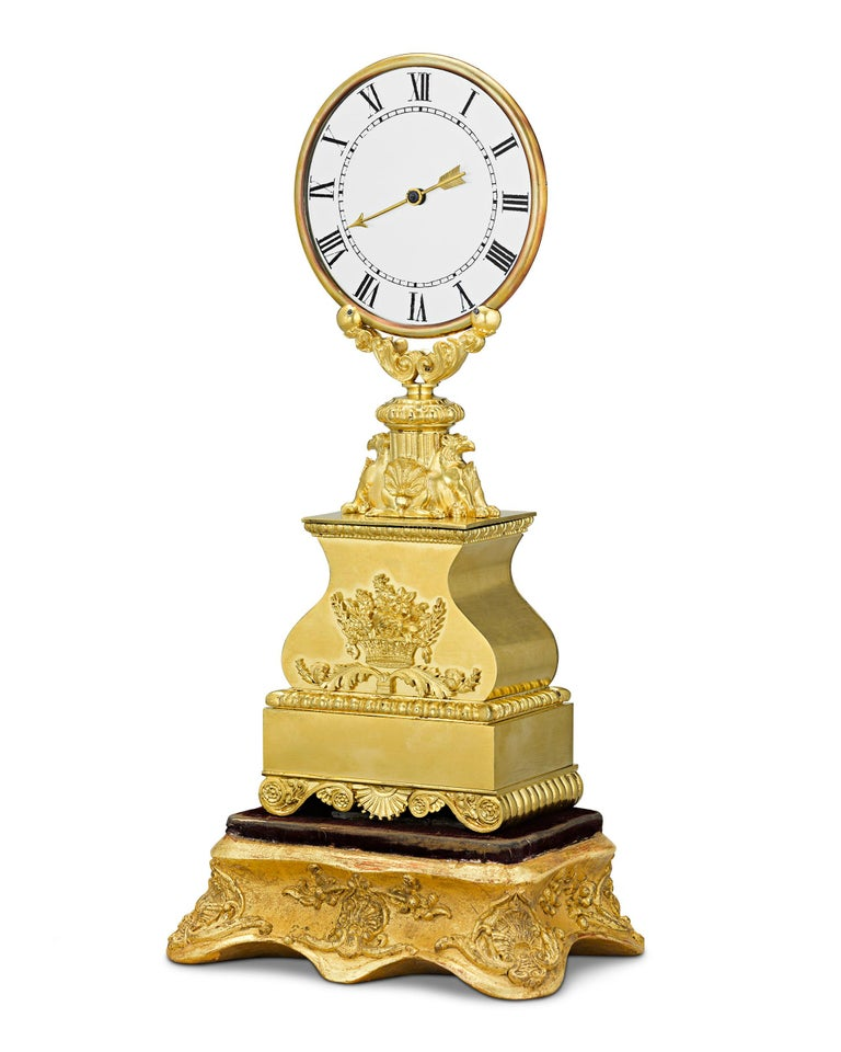 An unquestionable horological rarity, this regal gilt bronze mystery clock is the work of Jean Eugène Robert-Houdin (1805-1871), inventor, scientist, mechanical and horological genius and magician-extraordinaire. Houdin inspired successive