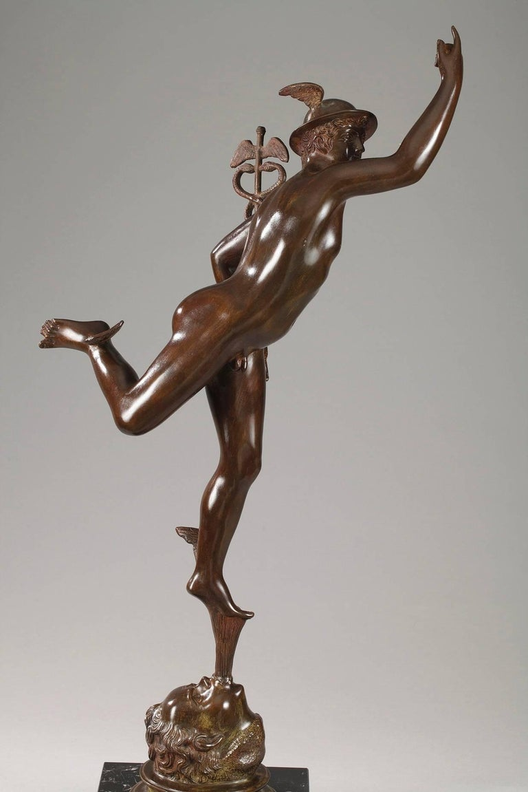 Large mythological bronze representing Mercury or Hermes, the messenger of the gods. He is wearing his winged, round petasos hat and carrying a caduceus in his left hand. The wings on his ankles enable him to move quickly and are one of his