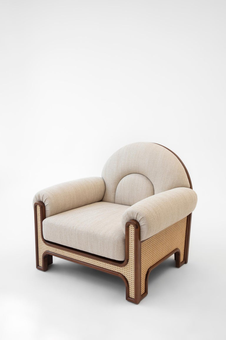 The N-gene armchair is a reinterpretation of an armchair designed by Merve's uncle, interior designer, Engine, in the 1970s. The N-Gene is re-envisioned with caning, and is upholstered in beige colored fabric. This entirely handcrafted armchair is