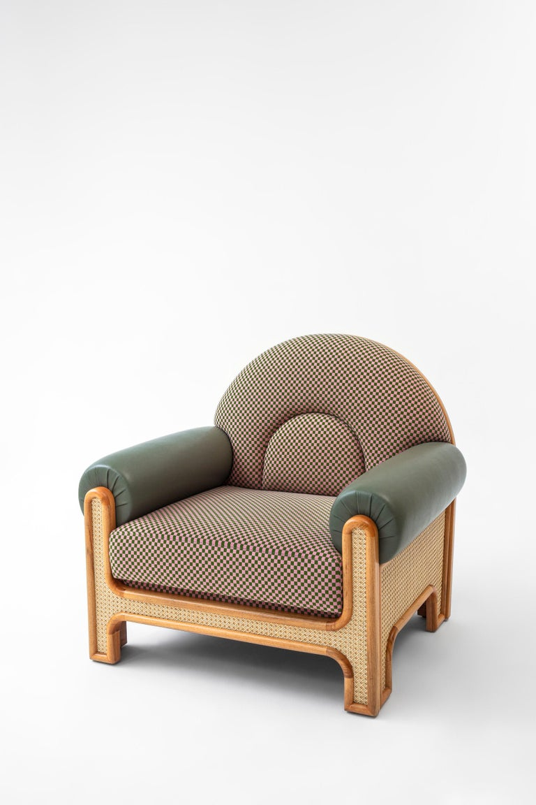 The N-gene armchair is a reinterpretation of an armchair designed by Merve's uncle, interior designer, Engin, in the 1970s. The N-Gene is re-envisioned with caning, and is upholstered in a checker textile with purple leather arms. This entirely
