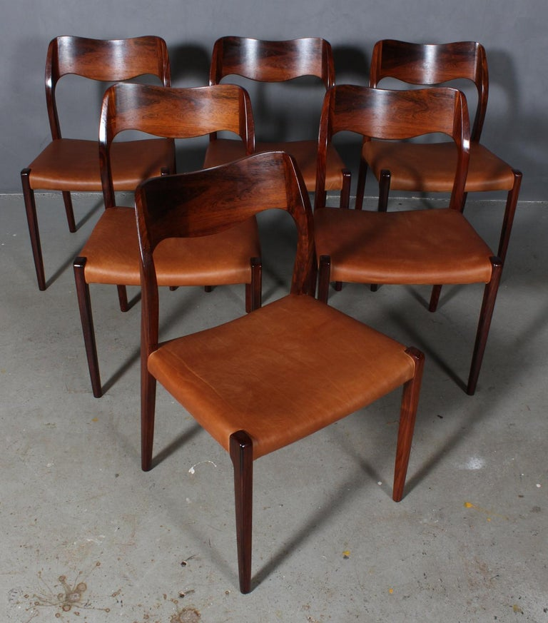 N. O. Møller set of six dining chairs in rosewood.  Seat new upholstered with vintage tan aniline leather.  Model 71, made by J. L. Møller, Denmark, 1960s.