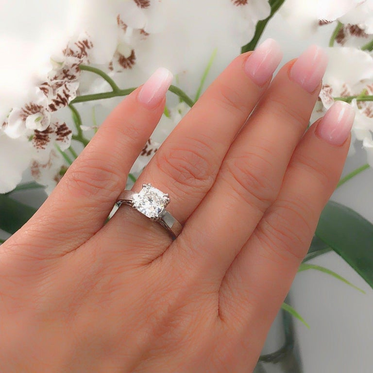 Na Hoku  Cushion Cut Diamond Solitaire Engagement Ring in 18kt White Gold.   Cushion Diamond is 1.97 CTS F color, VVS1 clarity.... diamond is inscribed NA HOKU IGI GT12278112.   Ring is Hallmarked NA HOKU 18K 1.97.   Size 5 - sizable.   Includes IGI