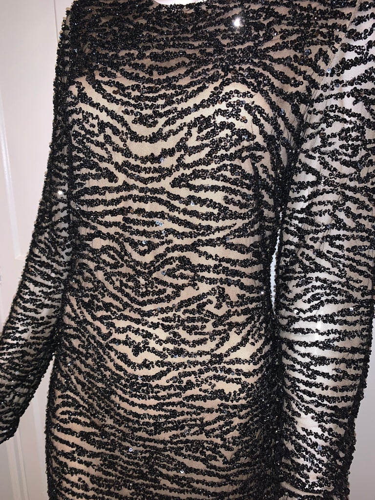 Naeem Khan Black and Cream Beaded Long Sleeve Beaded Cocktail Dress Tags still on.  Size 12 Long Sleeve and hits below the knee Black Beaded and Lined (not see through)  Zipper back  Such a glamorous, classy dress !   Retail $2995 +