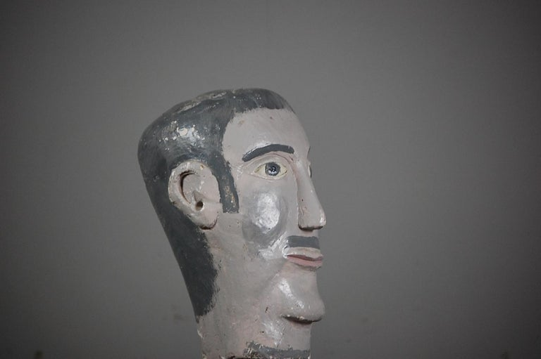 Naive plaster painted mannequin head, cheery and expressive. Probably used as a model for a hat or wig display in a retail setting, France, circa 1950.