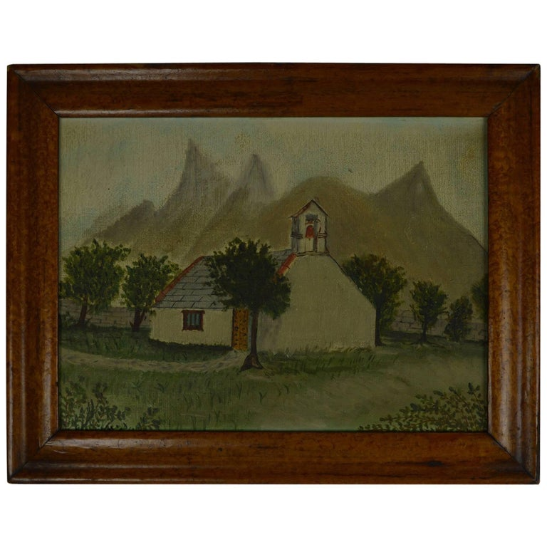 Charming image of a church in an alpine landscape.  Oil on canvas board.  English, late 19th century.  Artist unknown.  Presented in an antique bird's-eye maple frame.