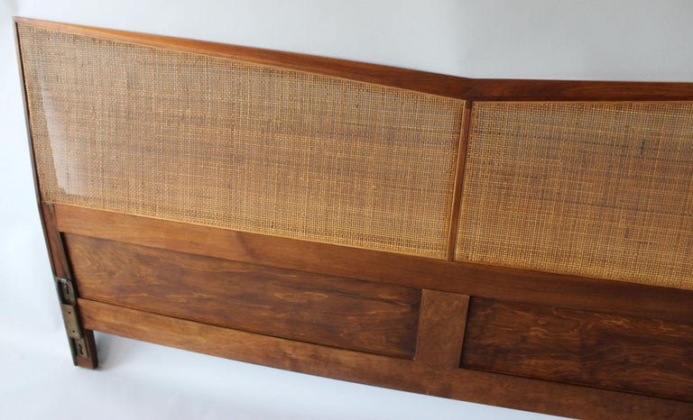 A gorgeous, angular walnut frame headboard with woven rattan details. Lovely side angles as well.