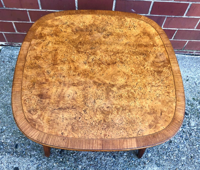 American walnut occasional or lamp table with burl maple inlaid top and hickory edge, circa 1957. Nice architectural details like exposed supports and octagonal carved legs. Unmarked and possibly custom made, although very similar to George