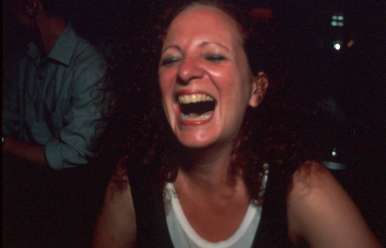 Cibachrome Signed and numbered in ink (lower right verso): Nan Goldin 19/200 Stamped in ink (lower right verso): Self-portrait laughing, Paris 1999 / Special edition to benefit / Partners in Health 2001 Edition 19/200