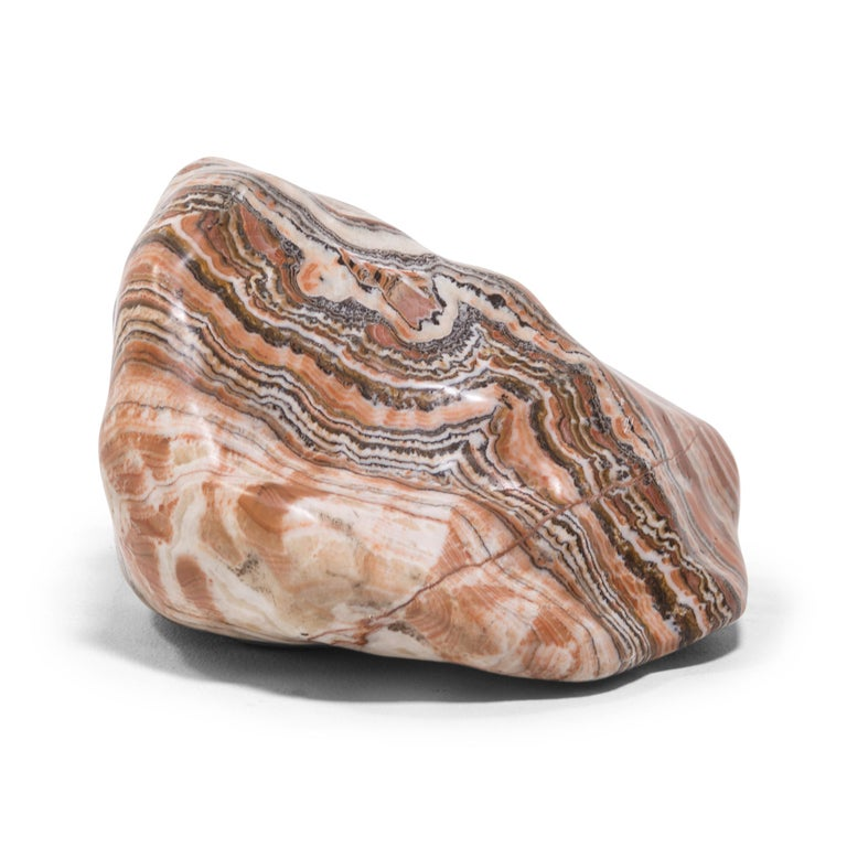 A well-chosen stone is a focal point of both a traditional Chinese garden and a scholar's studio - evoking the complexities of nature and inspiring creative thought. Sourced from China's Henan province, this nan yang meditation stone swirls with a