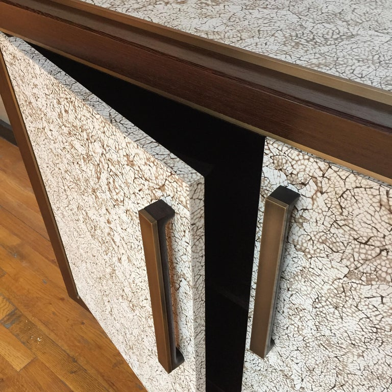 Door/appliance pull.  Metal finishes: Antique bronze, oil-rubbed bronze, polished nickel, satin nickel, satin brass, polished brass, or gunmetal.  Available in all polished metal (Upcharge)  Wood finishes: Wenge, walnut, or oak.  Enamel