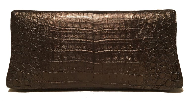 Nancy Gonzalez Bronze Brown Crocodile Clutch in very good condition. Bronze, metallic brown crocodile leather exterior with a magnetic top flap closure. Beige suede interior with one side slit pocket. Overall very good condition. No stains, smells
