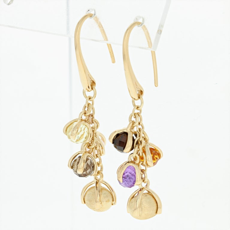 Flirty and playful, these beautiful Nanis earrings will be a delightful addition to your jewelry collection! This 18k yellow gold pair of Italian-made dangles feature glistening gemstone baubles and textured gold drops suspended along cable chain