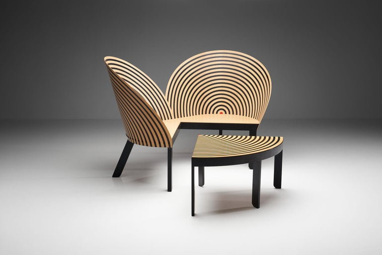 "The ""Bench for Two"" is a historic and iconic piece by Danish designer Nanna Ditzel. This innovative two-seater bench and table was the ""grand old lady of modern design"", Nanna Ditzel and Fredericia Furniture's first joint project in 1989. In 1990,"