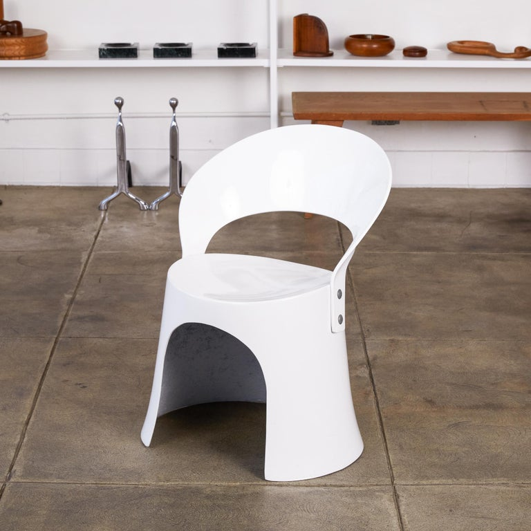 A single white fiberglass side chair by Nanna Ditzel for Odense Maskinsnedkeri. The Model 5301-2 was produced for retail by Domus Danica beginning in 1969 and has a simple, two-part construction with a Space Age sensibility. An oblong fiberglass