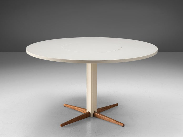 Nanna Ditzel for Kolds Savvaerk, pedestal table, wood, Denmark, 1950s  This elegant table has a slim base, well made with four tapered legs in solid wood. As the rest of the table is laquered white and the four legs show, their natural wooden