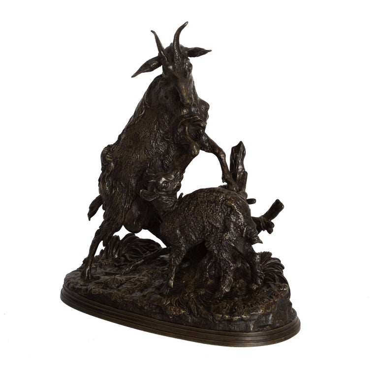 A rare and exceptional model of La Chévre et le Chevreau (The Nanny Goat and her Kid), it retains an exquisite original patina. Likely an atelier casting from Mene's own foundry, the hand chiseling and chasing executed by the foundry is exquisite,