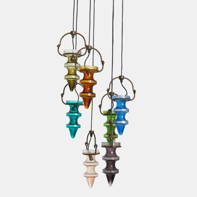 Nanny Still Stalactite chandelier for Dutch RAAK with seven different stalactites of art glass. Brass hardware. Holland, c. 1960's.