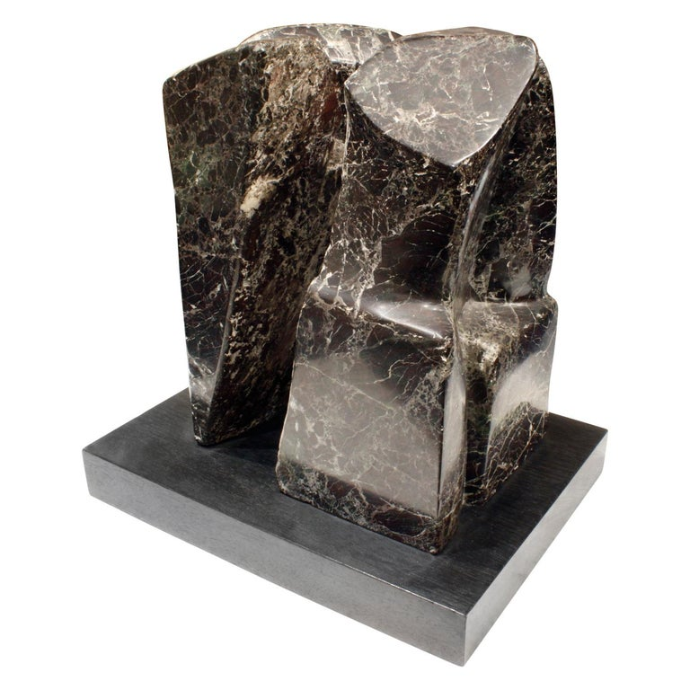 "Extraordinary hand-carved ""Fractured Planet"" sculpture in Italian Red Levanto marble on an ebonized wood base by Naomi Feinberg, American, 1960s.