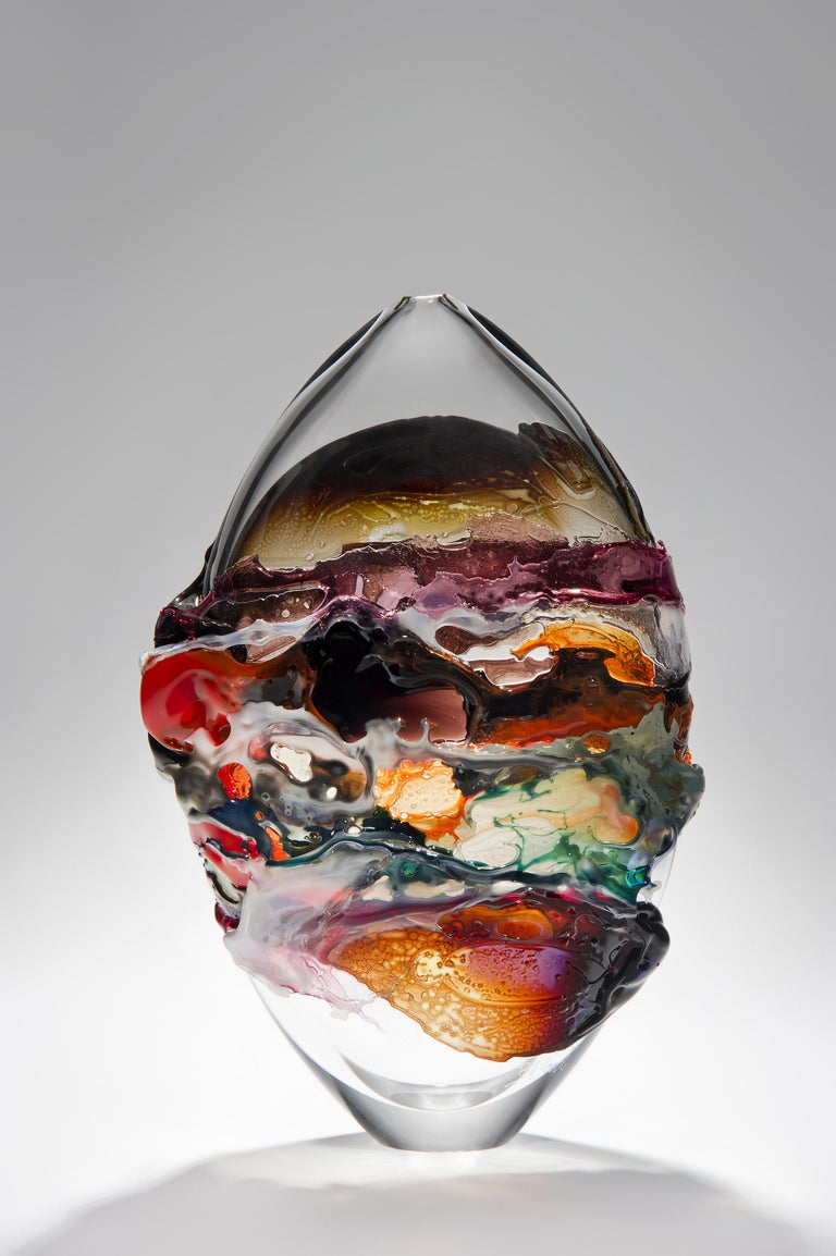 Naples II is a unique orange, brown and mixed colored glass vase from the Molten Landscapes collection by the British artist Bethany Wood. An equal passion for painting physically inspires how she controls and manipulates her glass. Recreating the